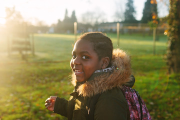 Young girl talking on her walk to school.