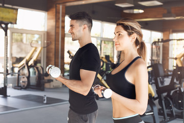 Young couple exercise together in gym healthy lifestyle