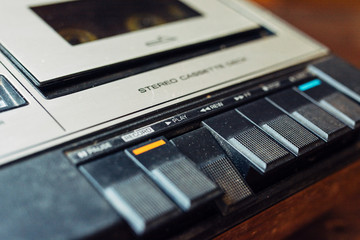Old cassette player buttons with play depressed