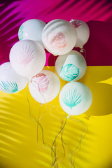 White balloons with paint on bright background
