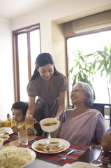 Woman serving her mother in law