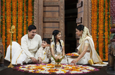 South Indian family with flower rangoli