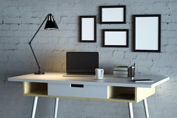 Designer desktop with empty laptop