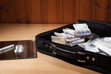 Briefcase full of drugs and money. Cocaine and cash.
