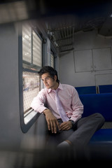 Businessman sitting inside a train