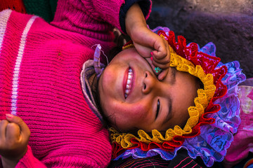 Andean indigenous child in traditional inca customs in Cusco, Peru