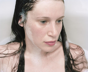 close-up of woman's face in bath