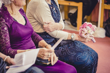 grannies in the church with a bouquet, grandma, old ladies, wedding guests