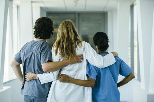 Doctor and nurses hugging