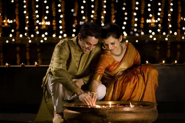 Couple lighting diyas