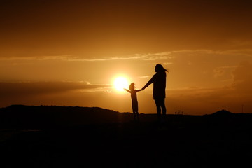Silhouette Child Mother