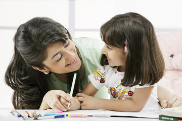 Mother and daughter with a colouring book