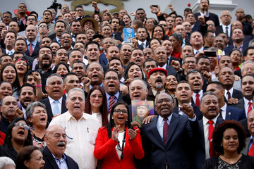 Members of the National Constituent Assembly pose for a family picture during its first session at Palacio Federal Legislativo, in Caracas