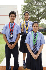 Students with medals and trophy