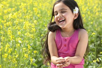 Young girl enjoying herself in a field