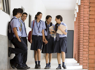 Students walking in the corridors of a school