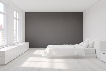 White bedroom with a gray wall