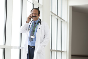 Doctor talking on a mobile phone