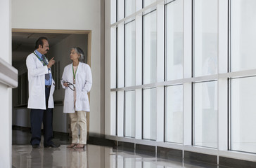 Two doctors talking in hospital corridor