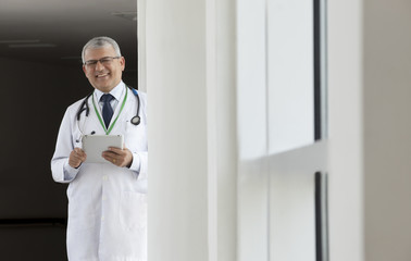Portrait of a doctor with a digital tablet smiling