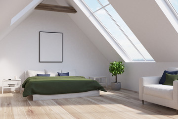 Attic bedroom with a green bed, poster, side