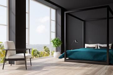 Black bedroom interior, tree, corner