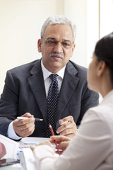 Mature business man discussing with female executive