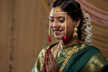 Beautiful Maharashtrian bride praying on her wedding day