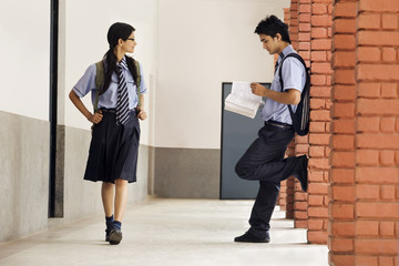 School girl looking at a school boy