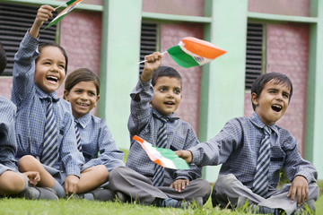 School kids holding the Indian flag