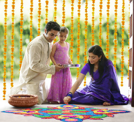 Family making a rangoli