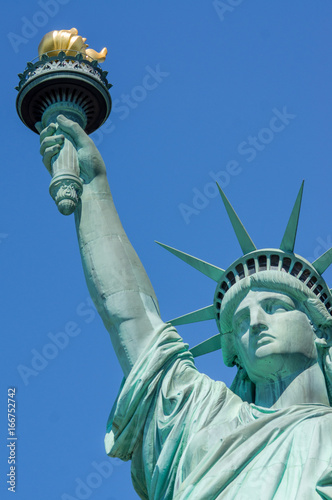 f70a22eec7047 Statue of Liberty up close on face, arm and torch