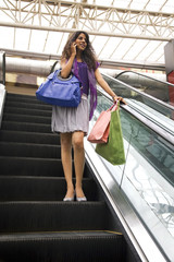 Full length of beautiful woman on escalator