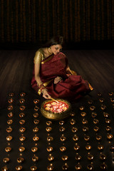 Woman lighting diyas