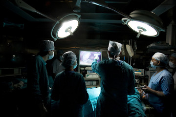 Surgeon looking at an operating screen
