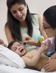 Doctor putting drops into a babies mouth