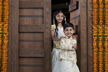 South Indian girl standing with her brother