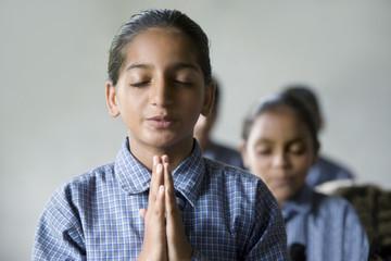 School girls praying