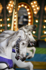 Horses on the carousel during the county fair