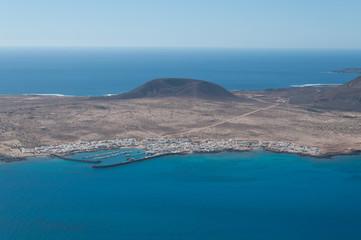 Panoramic view of Caleta del Sebo village, La Graziosa island, Canary Island