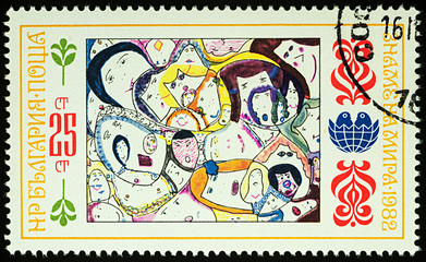 Faces - child's drawing on postage stamp