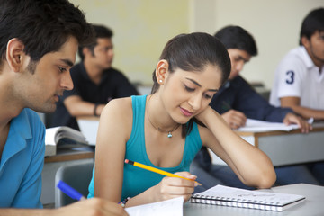College students studying in classroom