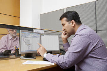 Business executive looking at a graph on a computer monitor