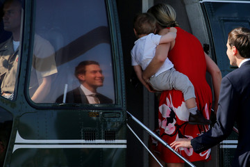 Kushner and Ivanka Trump board the Marine One helicopter with Trump to begin their summer vacation at his Bedminster estate, at Morristown Airport in Morristown, New Jersey