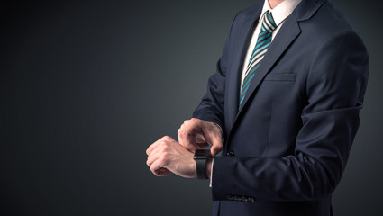 Man in suit wearing smartwatch.