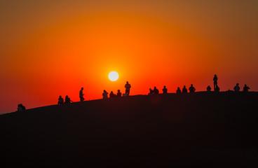 People watching sunset on the sand hills - Patara, Antalya