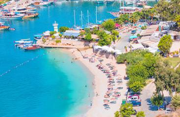 Holidaymakers sunbathing at Kalkan beach,