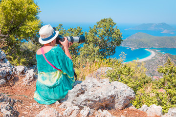 Nature photographer taking photos in the mountains - Oludeniz Turkey