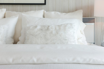 White shade pillows on off-white elegant bedding style interior bedroom