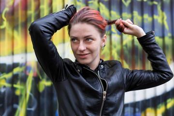 Young beautiful girl against graffiti